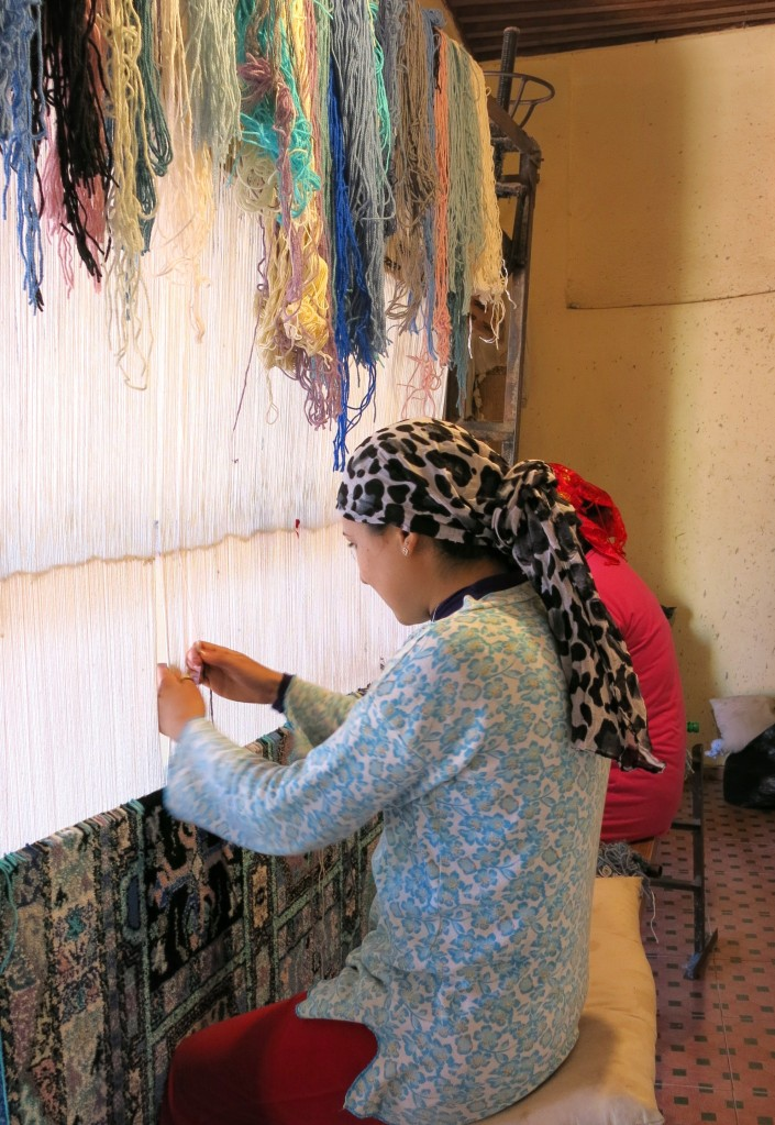 Rugmaker at Dar Zarbia co-op, Fes