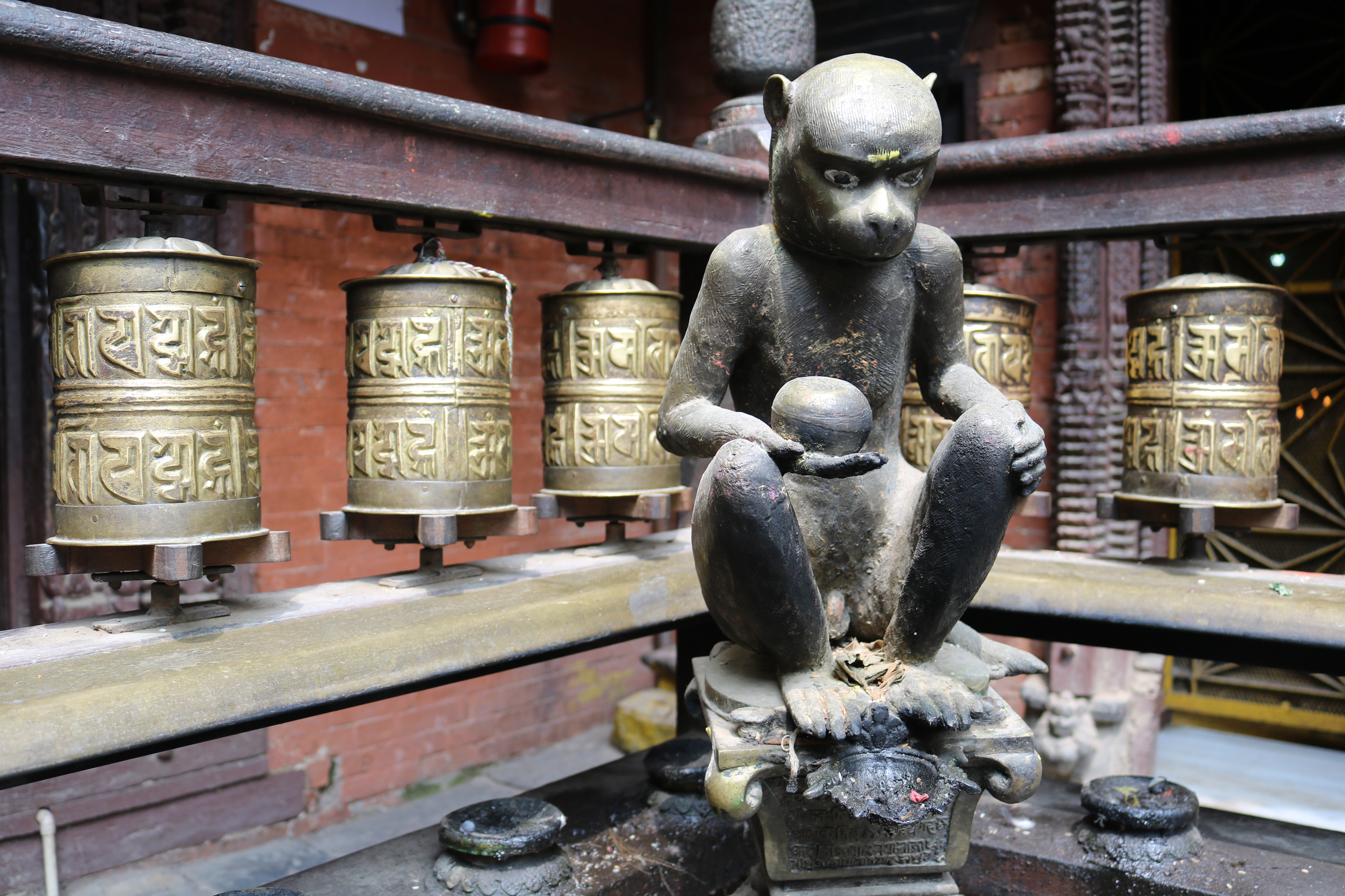Prayer wheels and monkey at Golden Temple